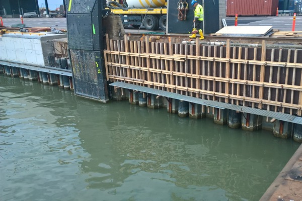 HDPE coated piles for renovation of sheet piled quay wall in West